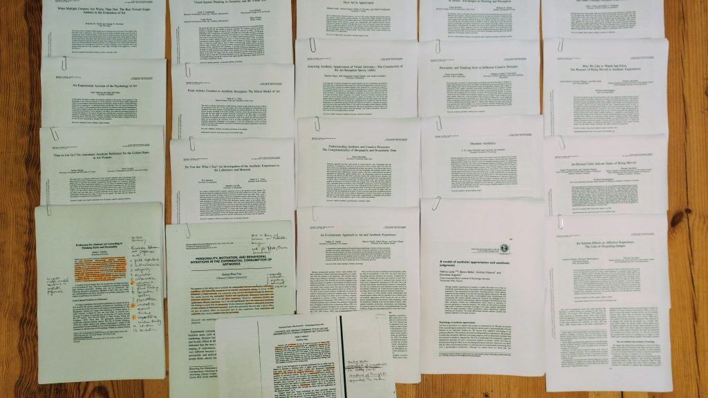 A large amount of scientific articles lying on the floor